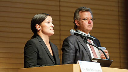 Image of Lisa Tenorio-Kutzkey and Dr. Bertold Bär-Bouyssière presenting