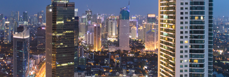Jakarta business district, along the Sudirman avenue, in Indonesia capital city at night.