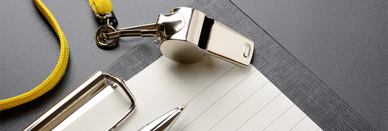 Image of a whistle and clipboard