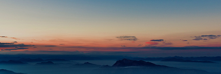 Horizon image of mountains and cloud cover at dawn